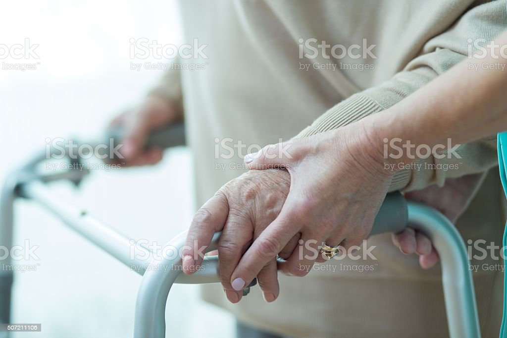 Close-up of woman using walker stock photo