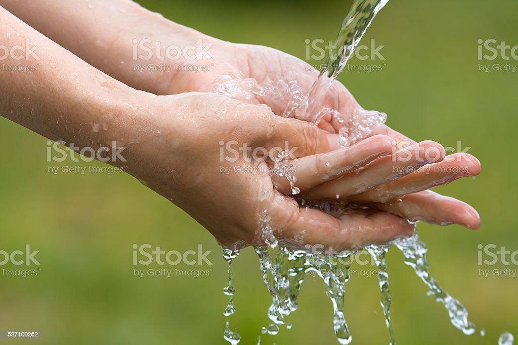 closeup of woman washing her hands stock photo