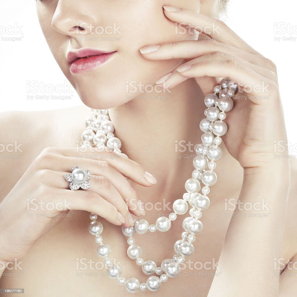 Close-up of woman wearing pearl necklace and ring stock photo
