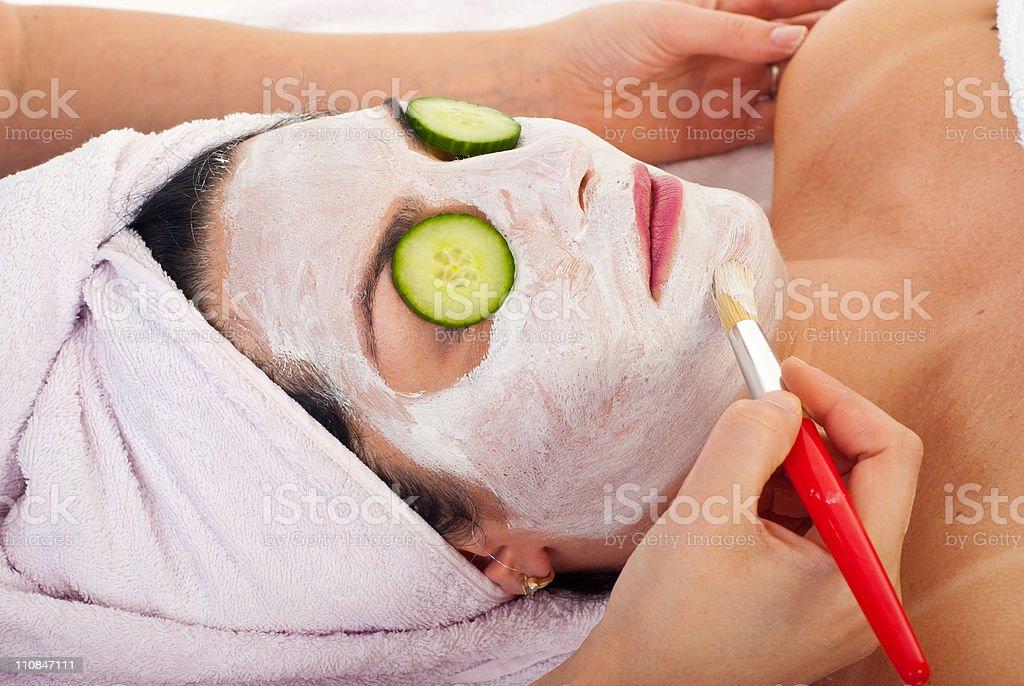 Closeup of woman with facial mask royalty-free stock photo