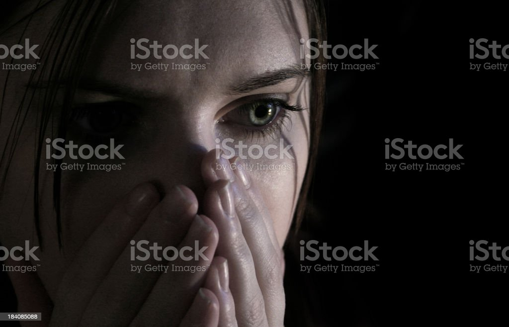 Close-up of woman with frightened expression royalty-free stock photo