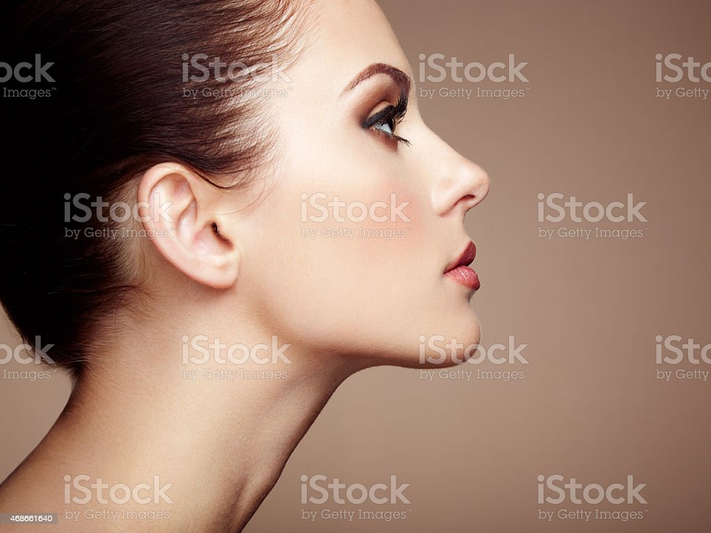 Closeup of woman with smooth skin and makeup stock photo