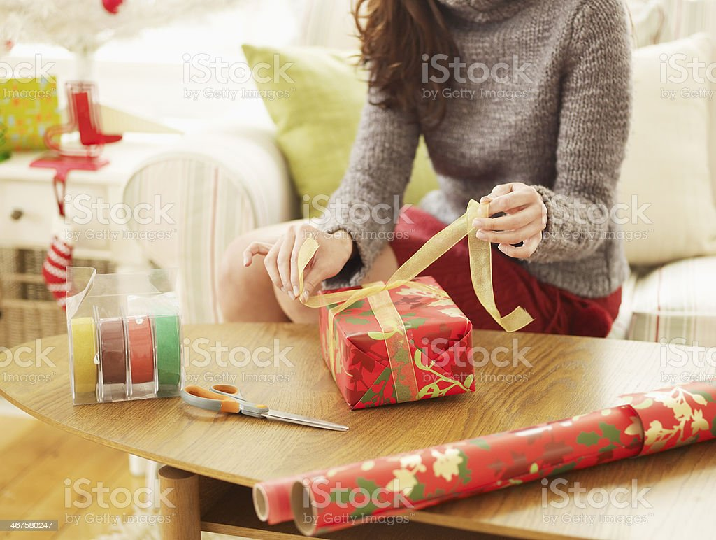 Close-Up of Woman Wrapping Christmas Presents stock photo