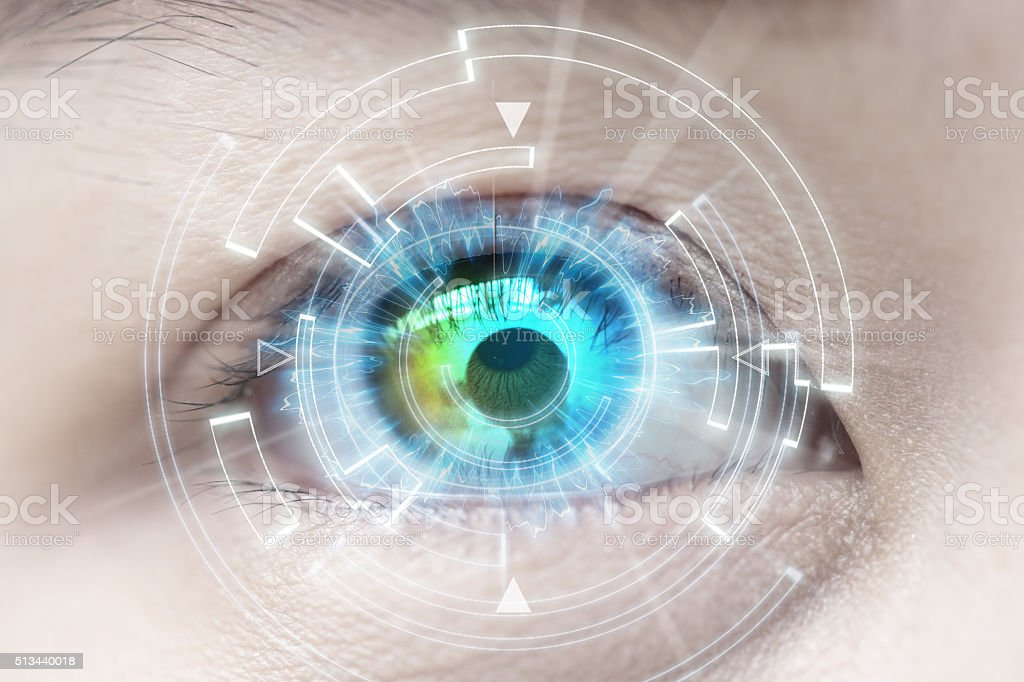Close-up of woman's blue eye. High Technologies, contact lens, c stock photo