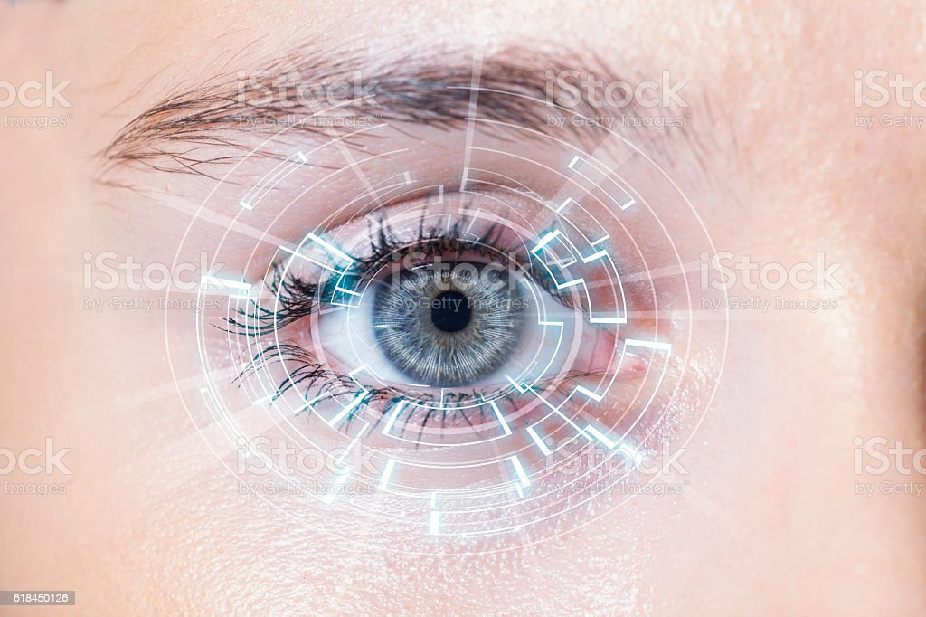 Close-up of woman's blue eye. High Technologies stock photo