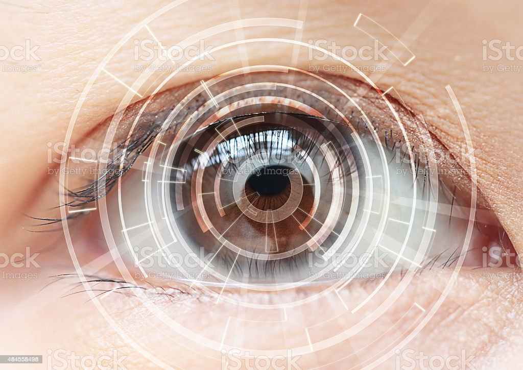 Close-up of woman's brown eye. High Technologies in the future stock photo