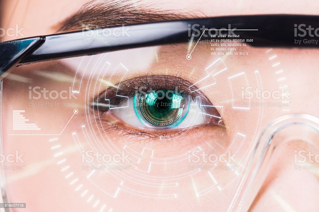 Close-up of woman's eye. High technologies in the futuristic. : stock photo