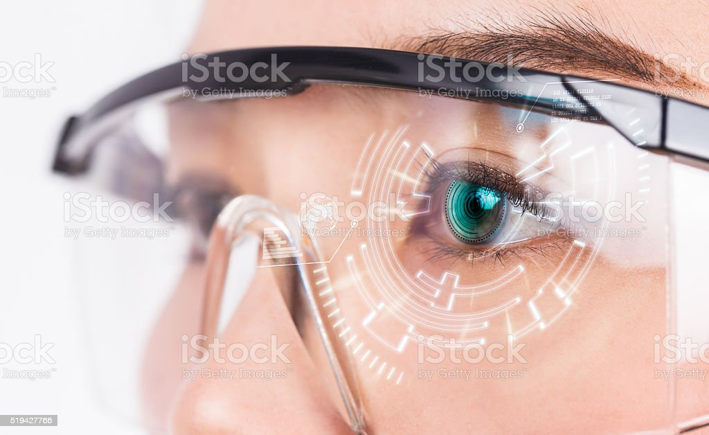 Close-up of woman's eye. High technologies in the futuristic. stock photo