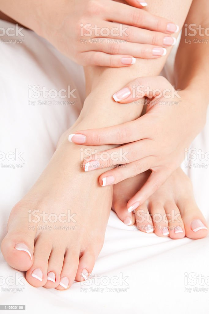 Close-up of woman's feet in sensual pose stock photo