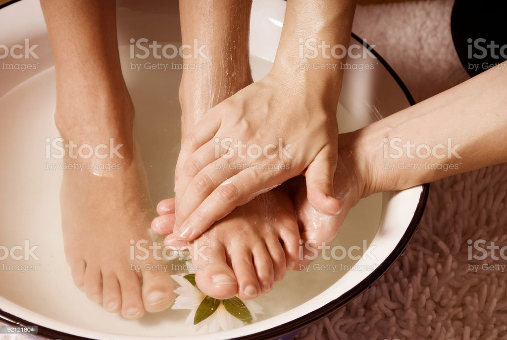 Close-up of woman's feet on a bowl getting a pedicure royalty-free stock photo