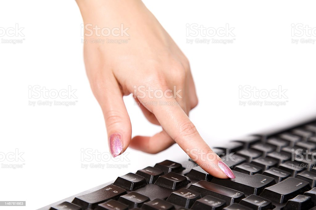 Close-up of woman's hand touching computer keys royalty-free stock photo