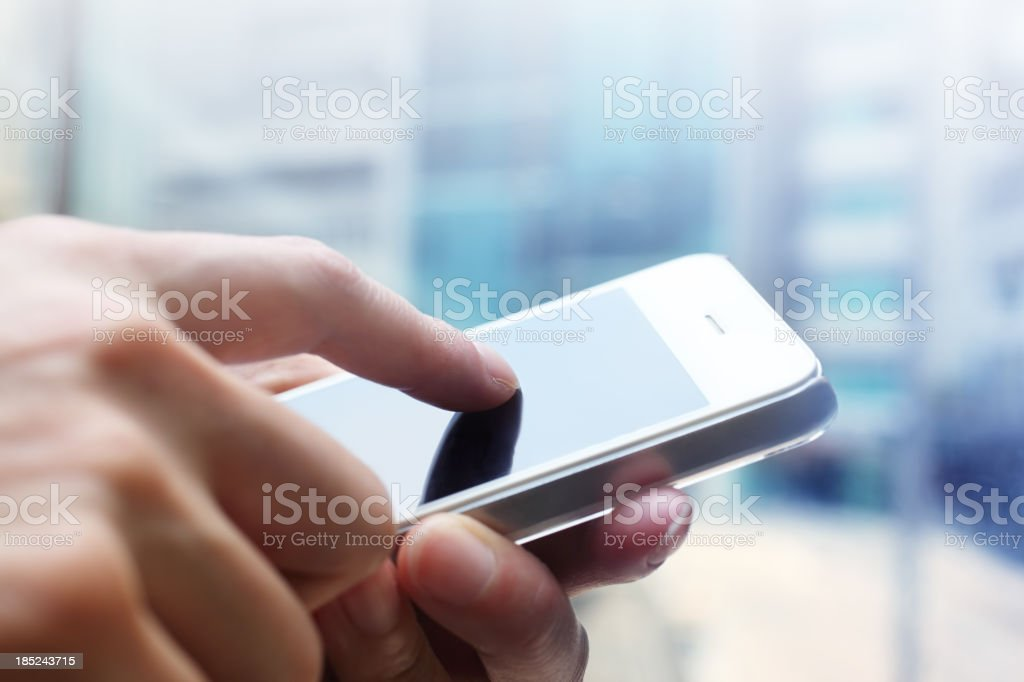 Close-up of woman's hands with smartphone stock photo