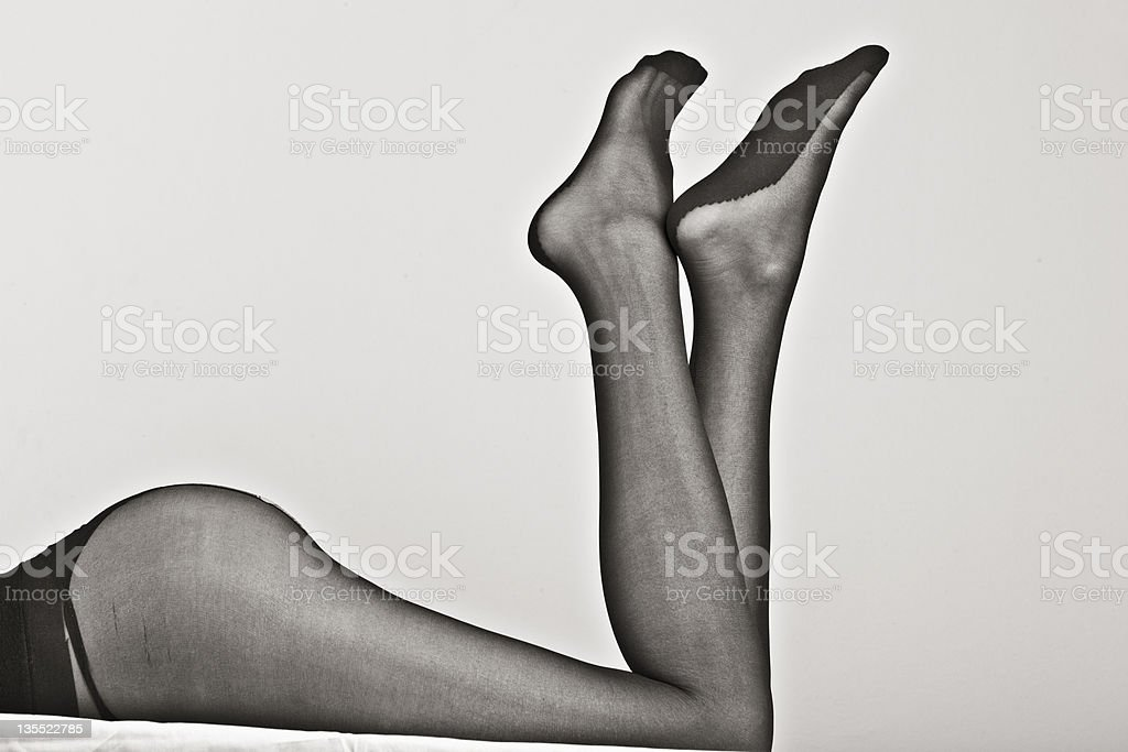 Close-up of woman's legs in blank sheer stockings stock photo