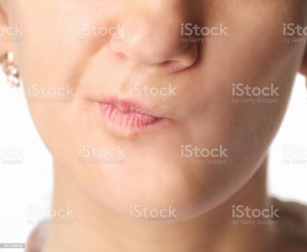 Close-up of woman's lips with rooked smile expression stock photo