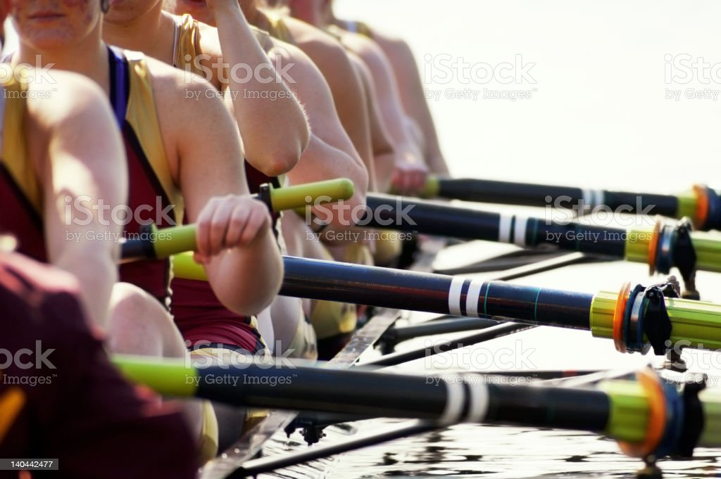 Close-up of women's rowing team blown-out stock photo