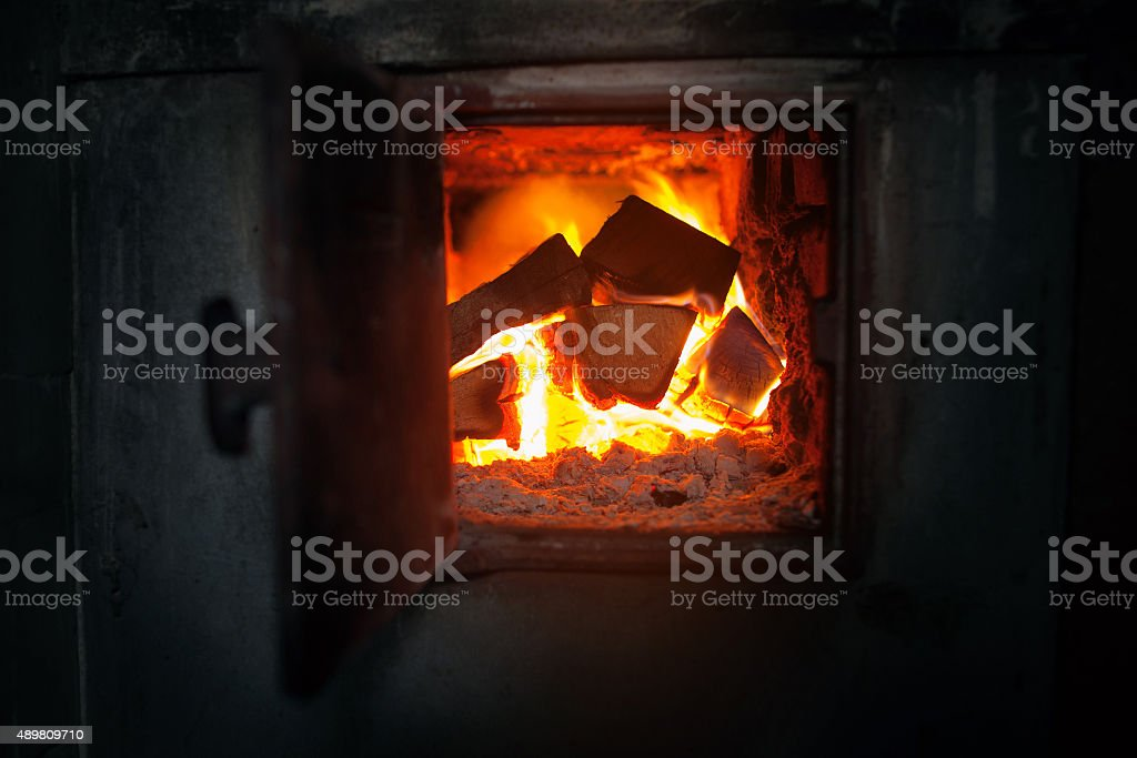 closeup of  wood stove with the burning firewood. stock photo
