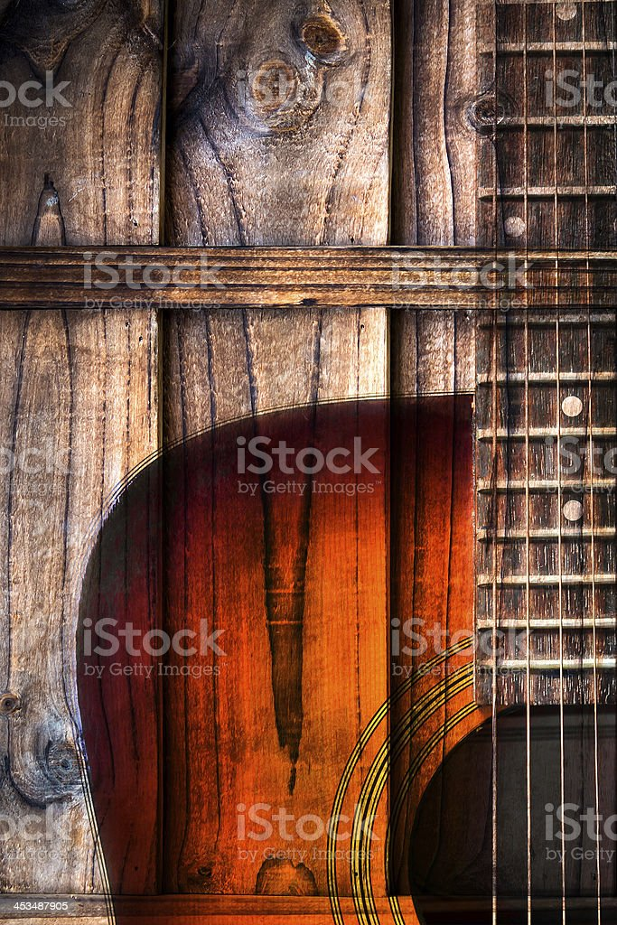 Close-up of wooden acoustic guitar over a wooden background stock photo