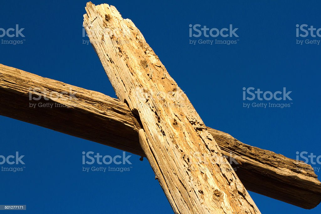 Close-Up of Wooden Cross Against Deep Blue Sky stock photo