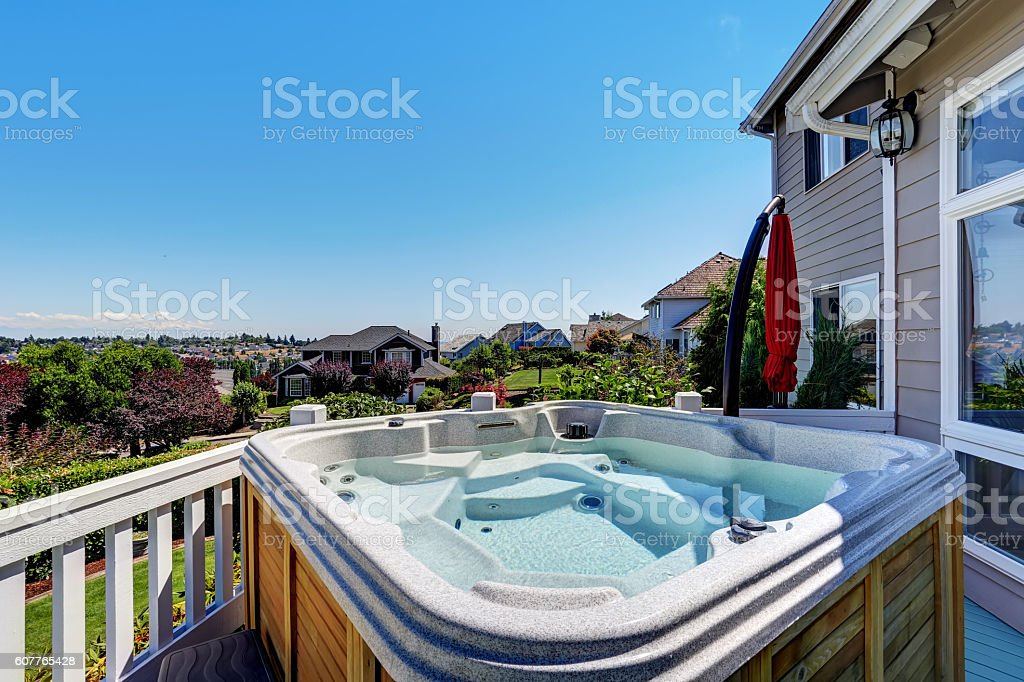 Close-up of wooden hot tub. Luxury house exterior. stock photo