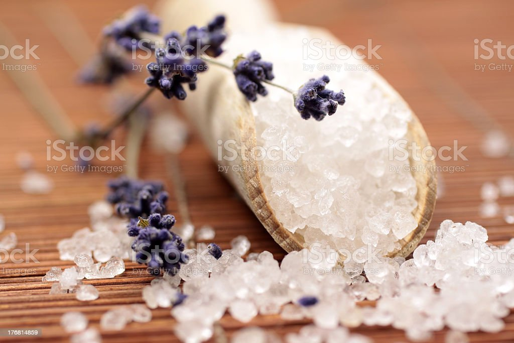 Close-up of wooden shovel with coarse bath salt stock photo