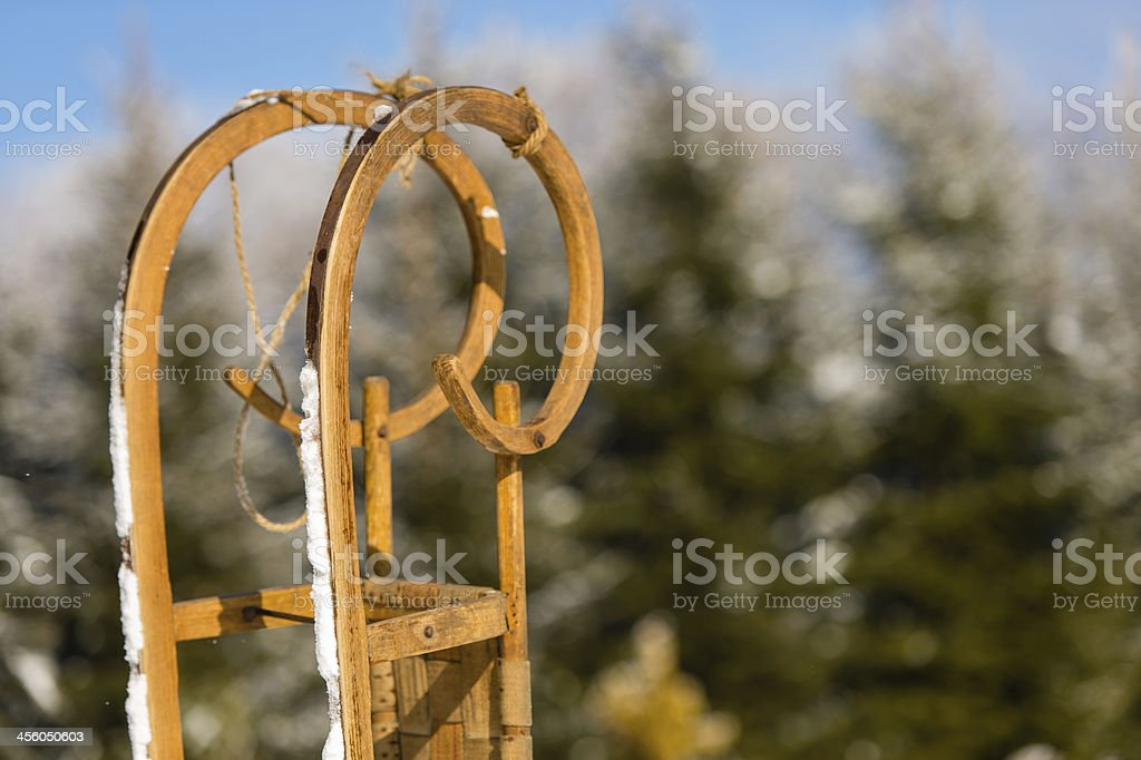 Close-up of wooden sledge standing snow winter forest stock photo