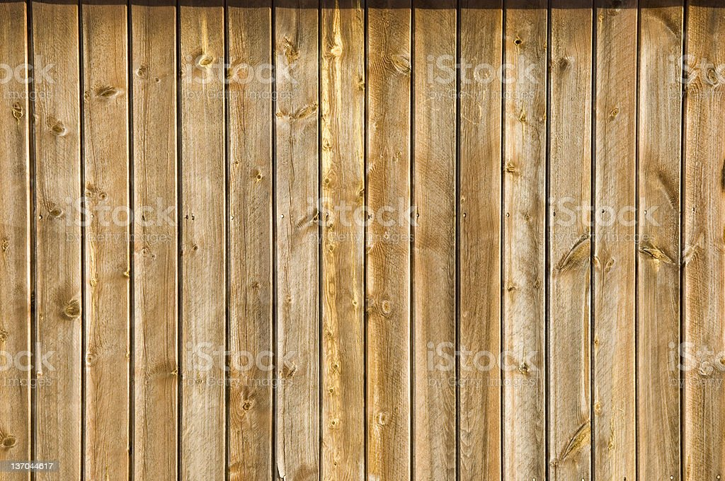 Close-up of wooden wall comprised of long planks stock photo
