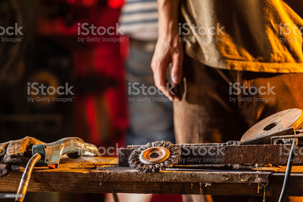 Close-up of worker in workshop stock photo