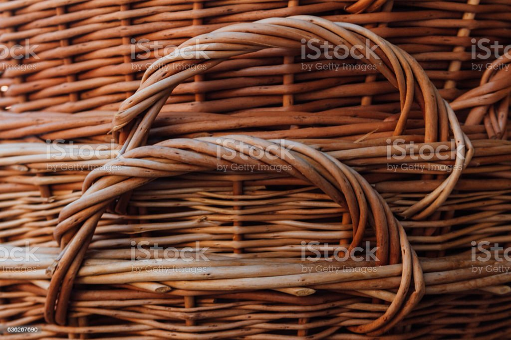 Close-up of woven wicker baskets stacked stock photo