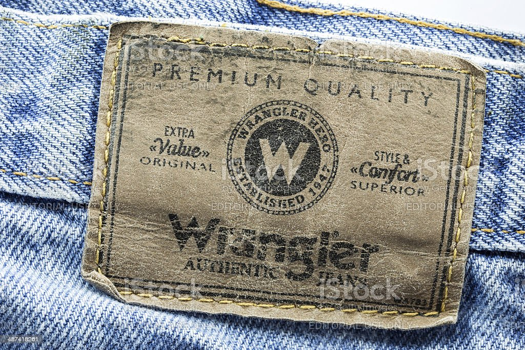 Closeup of wrangler leather label sewed on a blue jeans stock photo