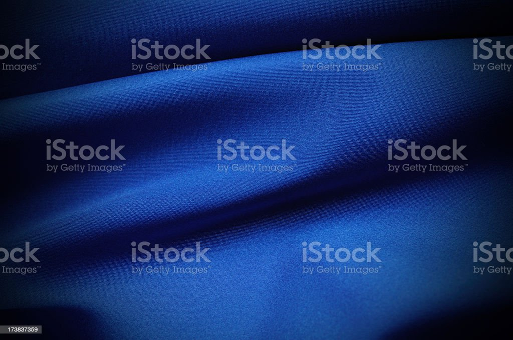 A close-up of wrinkled blue satin stock photo