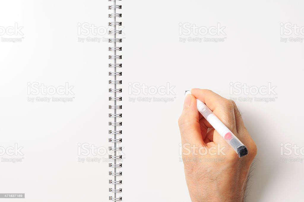 Close-up of writing a spiral notebook like a whiteboard royalty-free stock photo