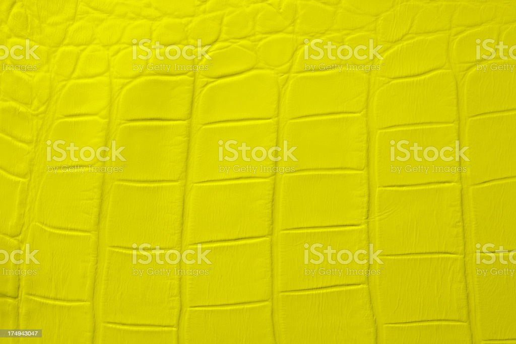 Close-up of yellow bumpy leather texture background royalty-free stock photo