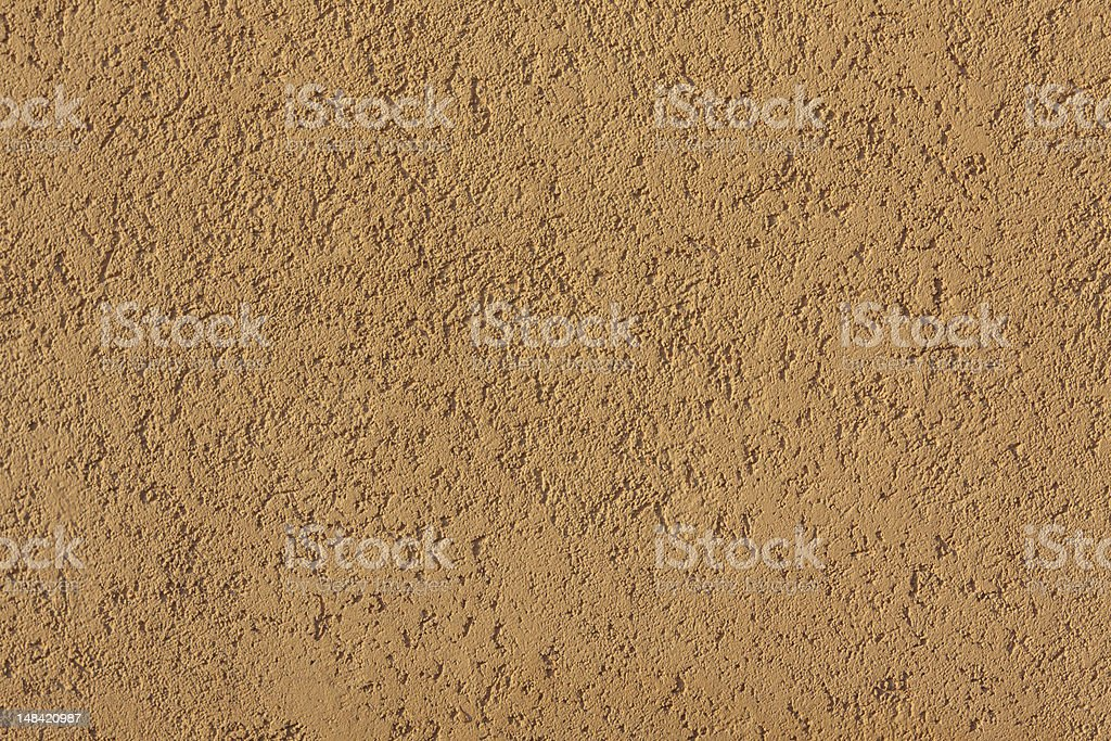 close-up of yellow concrete wall stock photo