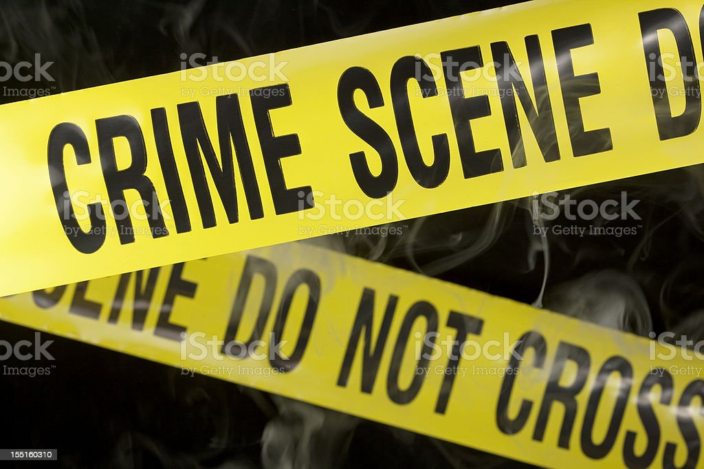 Close-up of yellow crime scene tape on black stock photo