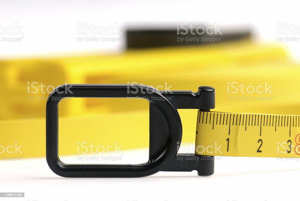 Closeup of yellow measuring tape royalty-free stock photo