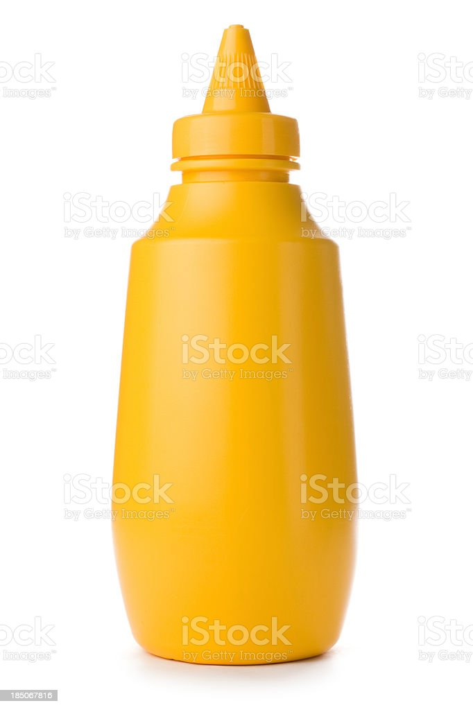 Close-up of yellow mustard bottle on a white background stock photo