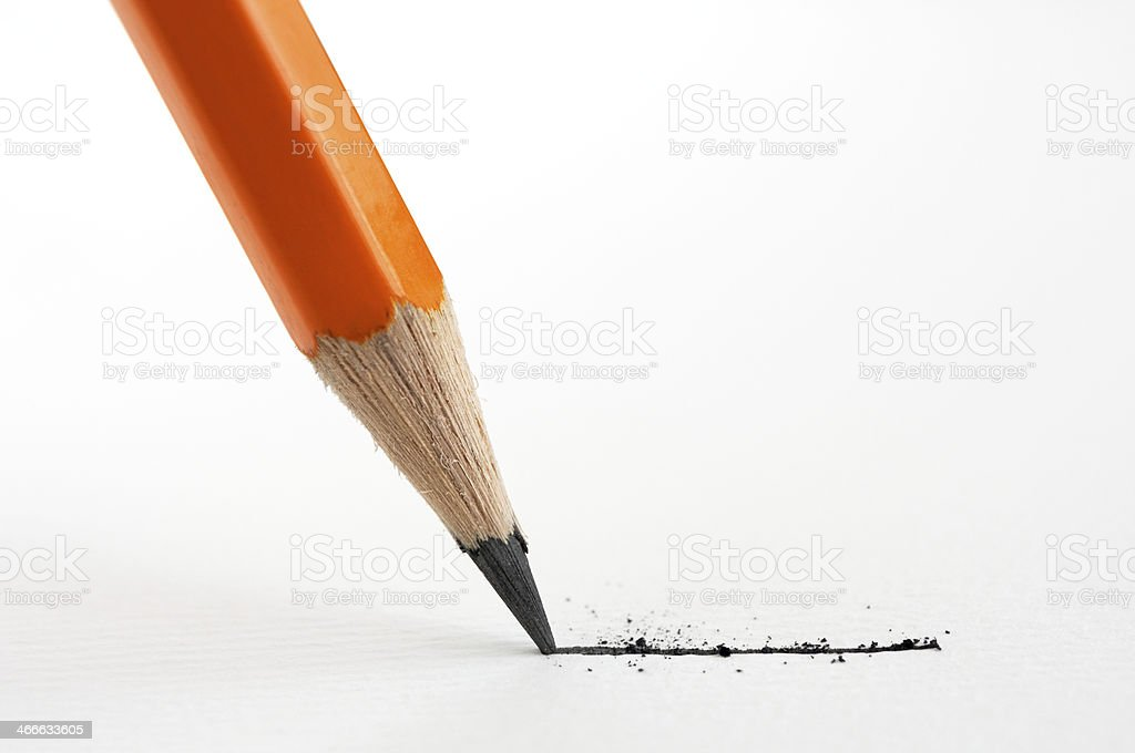 Close-up of yellow pencil drawing rough line stock photo