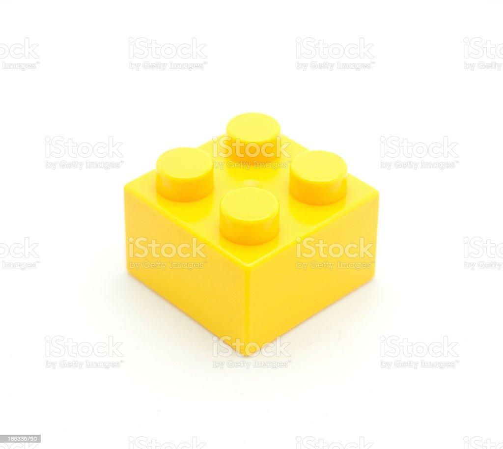 Close-up of yellow plastic Lego block stock photo
