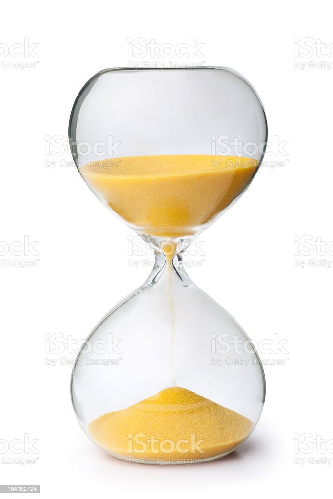 Close-up of yellow sand inside an hourglass stock photo
