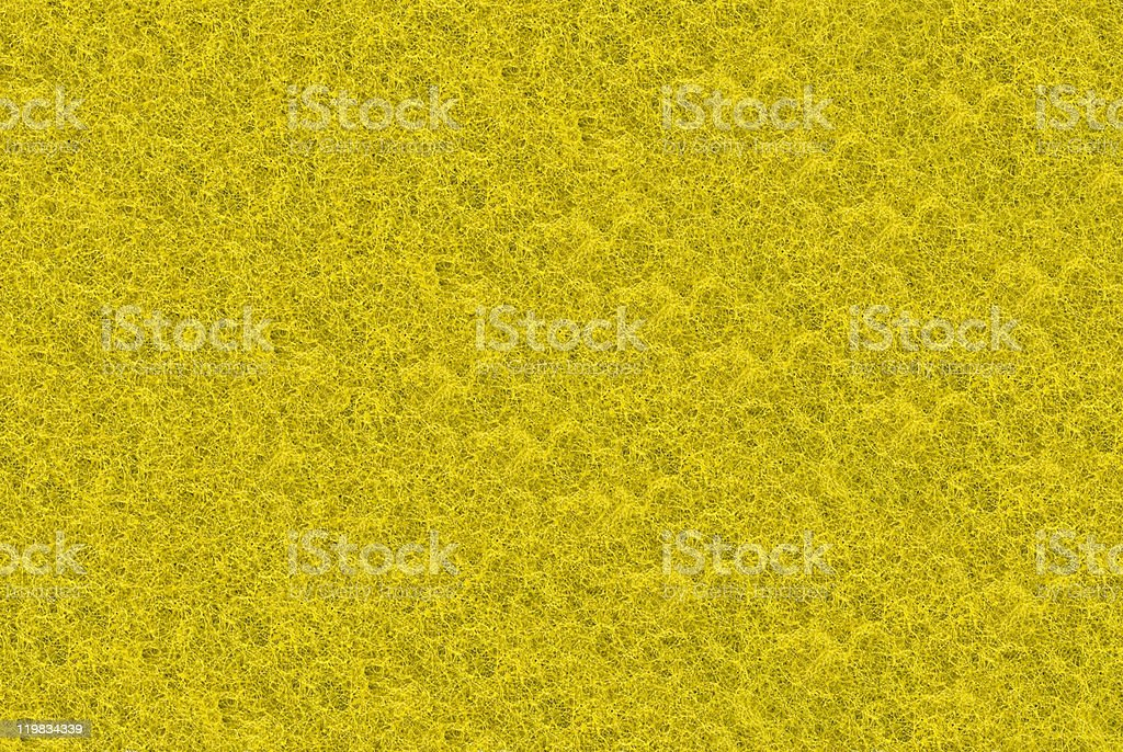 Close-up of yellow synthetic fibrous surface stock photo