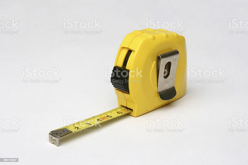 Close-up of yellow tape measure with metal clip stock photo