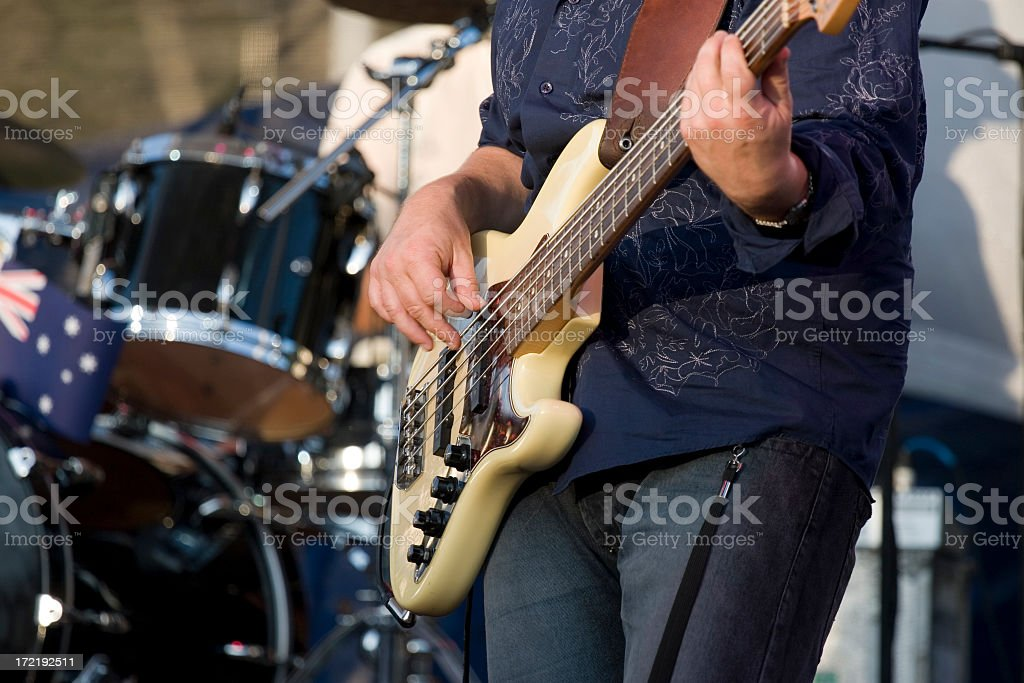 Close-up of yellow-colored electric guitar used by player stock photo