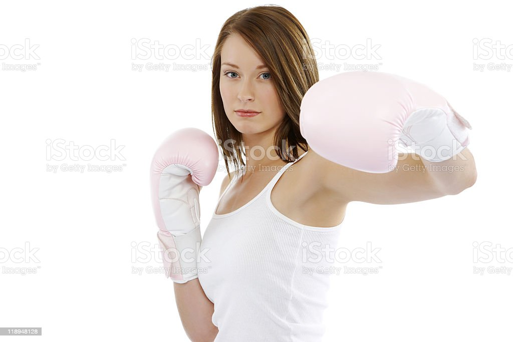 close-up of young attractive Female boxer punching on white background stock photo