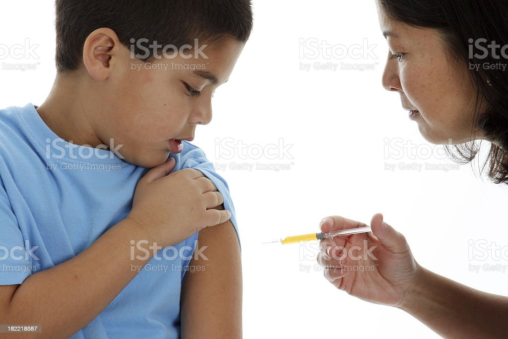 Close-up of young boy receiving and injection from Pediatrician stock photo