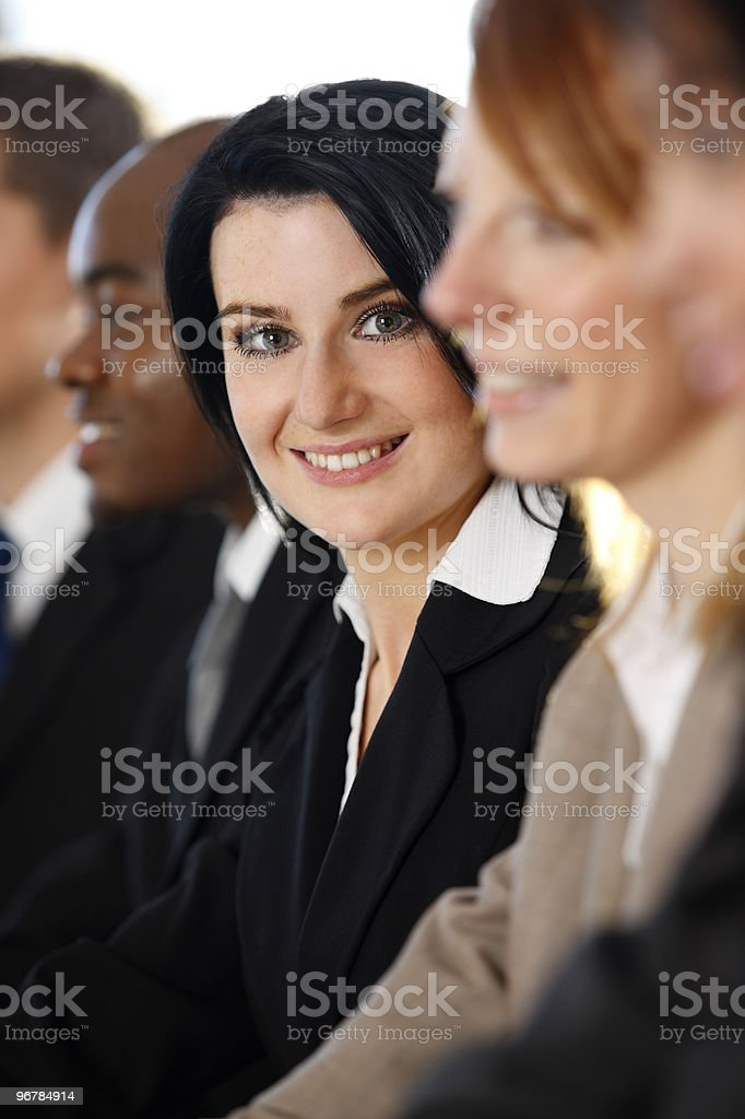close-up of young business woman working with colleagues in office royalty-free stock photo