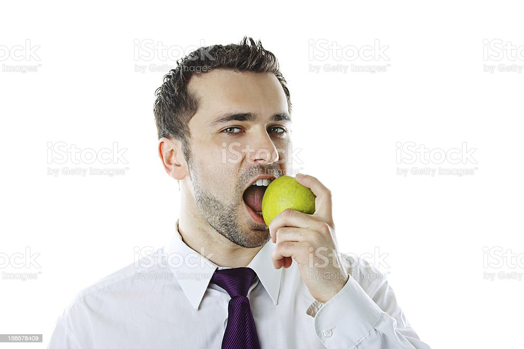 Close-up of  young businessman biting an apple royalty-free stock photo
