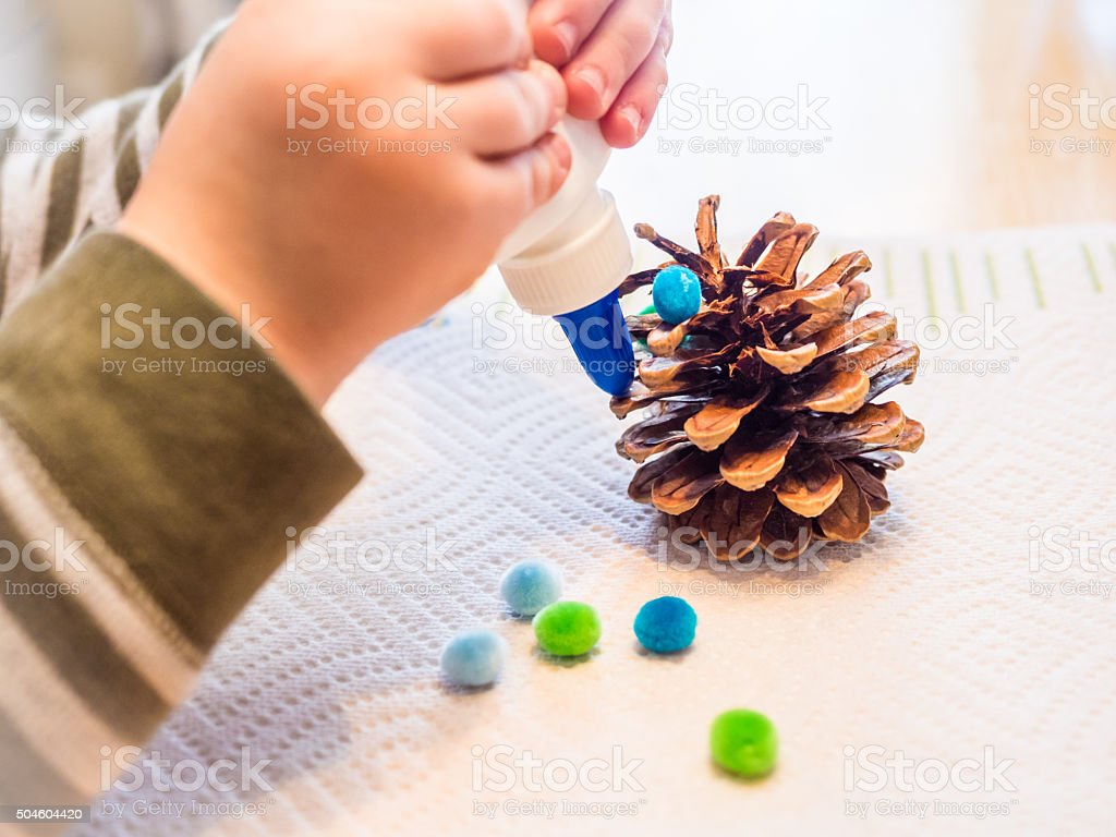 Closeup of Young Child Making a Craft stock photo
