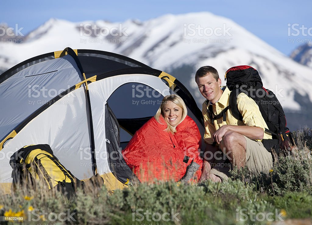 Close-Up Of Young Couple Camping In The Mountains royalty-free stock photo