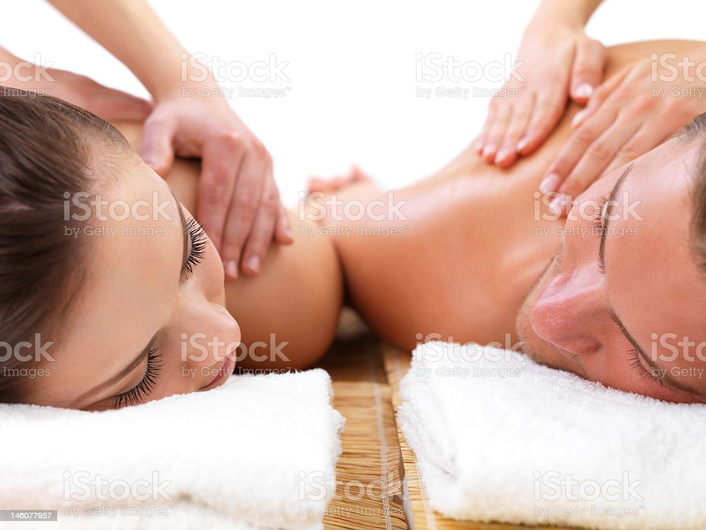 Close-up of young couple receiving shoulder massage at day spa royalty-free stock photo