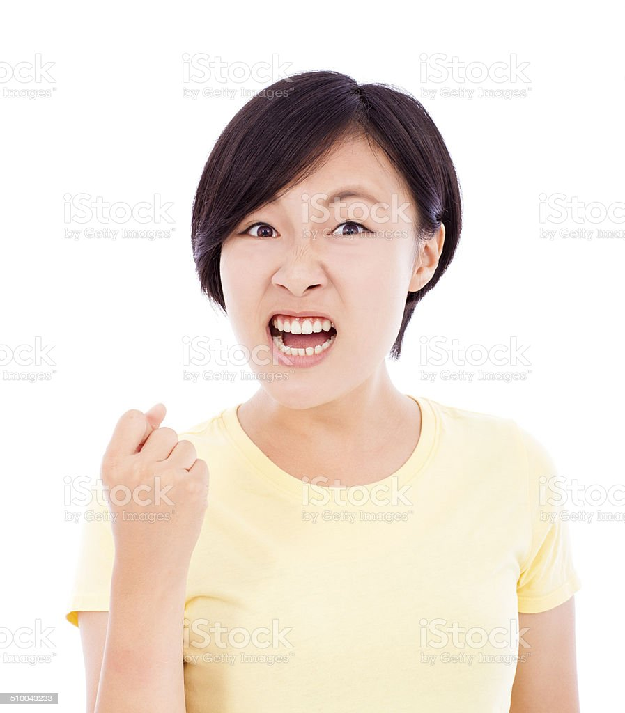 closeup of young girl angry facial expression stock photo